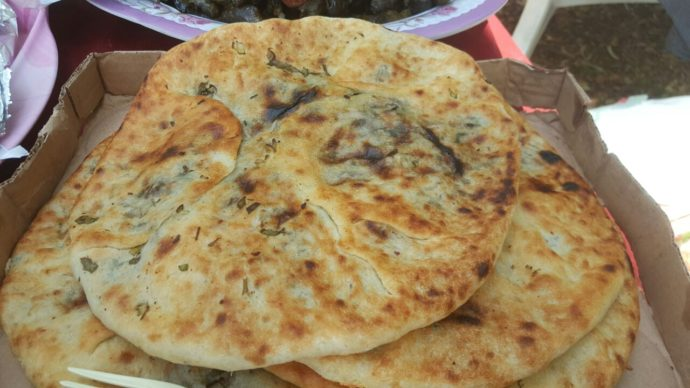 Fresh stuffed pita, straight out of the oven: one of the most beloved dishes on our Druze culinary experience.