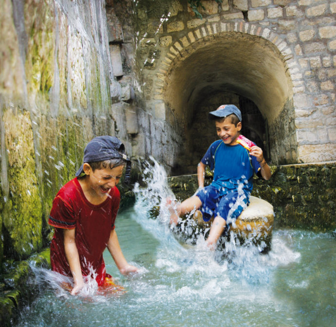 kids playing in water old city of jerusalem