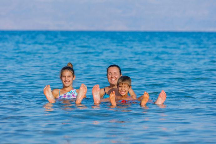 Family floating in Dead Sea