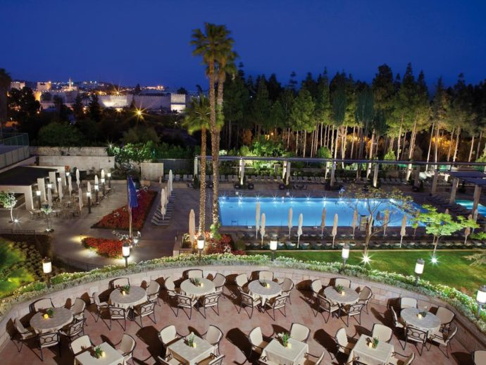 Overview of the outdoor pool and restaurant from the hotel