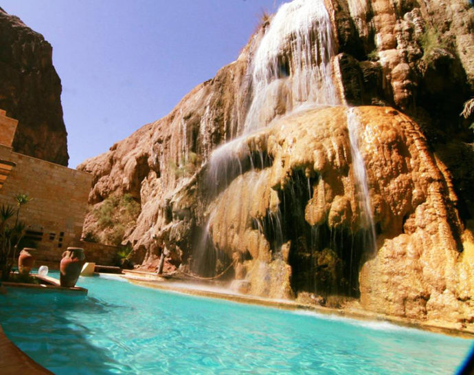 waterfall and pool at main hot springs resort jordan